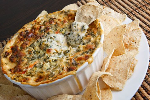Bubbling cheese, crab, spinach and artichoke dip – Tastetickler